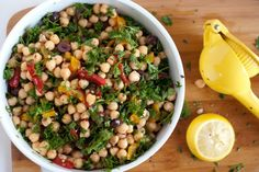 •Two cans of chickpeas, rinsed and drained  •1/2 cup+ roasted red and/or yellow peppers, chopped  •1/4 cup sliced kalamata olives  •1/3 cup sliced Cherry tomatoes,  •Small bunch of parsley, chopped  •Scallions, chopped  •Minced garlic  •Juice of one lemon  •Olive oil  •Salt and pepper