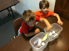 Montessori inspired activity, spooning ping pong balls