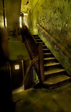 "I want a photo shoot here! Staircase of an abandoned state hospital. Love the peeling paint, the worn stone steps, and the open door leading to the ""exit"". Abandoned Asylums, Abandoned Places, Old Buildings, Abandoned Buildings, Mental Health Facilities, Scenery Photography, Stairway To Heaven, Urban Exploration, Ruins"