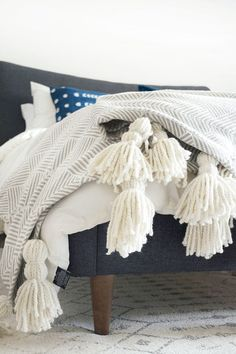 DIY Giant Tassel Throw Blanket- For our snuggle please basket in the L.Room. Guests love to grab a warm blanket or fluffy pillow to lay on or wrap themselves up in and they don't have to ask...it's a basket, right there in the L.Room.