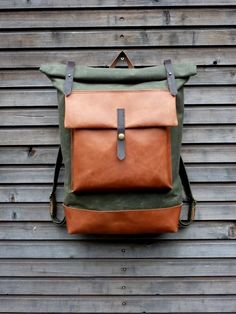 Image of Waxed canvas backpack with roll top and oiled leather bottem COLLECTION UNISEX