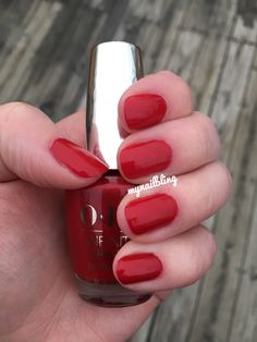 "This is ""Relentless Ruby,"" a shade from OPI's Infinite Shine collection. It's a ""gel/polish hybrid"" that needs no light to dry and is supposed to last 10 days. We'll see! It dried super-quick, too!"