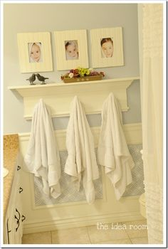 Love the idea of kids 'after bath' pics in frames for the bathroom and hooks to coordinate with each one. Great way to teach kids to hang up their towels- and they don't have to read to know which one is theirs!