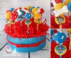 Blue, red and yellow Paw Patrol cake pops with chocolate dog bones - Cake Pops - SmartieBox Cake Studio