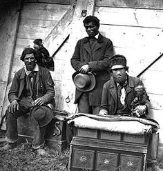 CANADA, 1859 -- A roadside scene of itinerant street musicians with organs and monkeys.