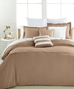 Lacoste Solid Mink Brushed Twill Duvet Cover Sets $128.99 Soft fabric and a timeless mink tone finish update your modern bedroom décor with the luxurious warmth and style provided by these solid comforter and duvet cover sets from Lacoste.