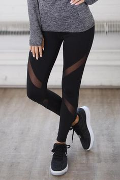 Your workout style will be on point in these trendsetting cutout leggings! Black activewear leggings with mesh cutout detail. Zip pocket on back of waistband. W