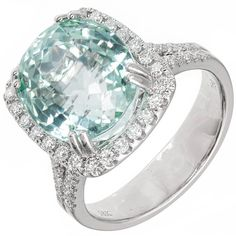 Natural Mint Green Tourmaline Diamond Halo White Gold Ring | From a unique collection of vintage more rings at https://www.1stdibs.com/jewelry/rings/more-rings/
