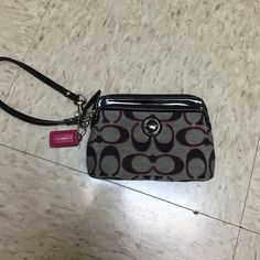 Coach wristlet Coach wristlet super cute.  Used still in good shape. There is cracking on the strap. Coach Bags Clutches & Wristlets