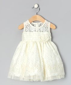 Take a look at this Ivory Rosette Dress - Infant, Toddler & Girls by Rosenau Beck: Fancy Frocks on #zulily today!