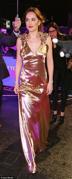Turning up: Dakota didn't let the downpour dampen her spirits and confidently strutted ont...