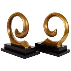 Rare Pierre Cardin Logo Sculptural Bookends | From a unique collection of antique and modern bookends at https://www.1stdibs.com/furniture/more-furniture-collectibles/bookends/
