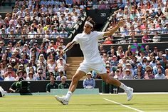 Roger Federer charges the net on No.1 Court