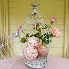 Distressed metal wedding birdcage. This beautiful distressed white birdcage will add a stunning centrepiece to your wedding decorations. Fill with flowers or decorations of your choice to suit your wedding theme.