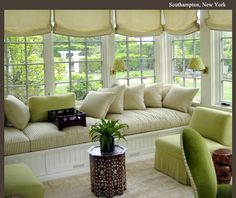 Relaxing sunroom - love the built in bench and all the natural light.  What a great place to sit and read.