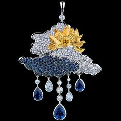 Clouds Pendant 18K white gold, 195 diamonds 1,86-1,88 ct, 55 yellow diamonds 0,17-0,19 ct, 137 blue sapphires 3,89-3,92 ct. by Jewellery Theatre -R 4 300 WYP13.