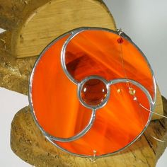Orange Stained glass Celtlic Triskelion by RainbowStainedGlass