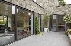 Completed in 2016 in London Borough of Lewisham, United Kingdom. Images by Anna Stathaki. Located on an urban infill site in close proximity to the River Quaggy in Lewisham, No. 49 is a new-build, two-storey single dwelling. Architecture Office, Landscape Architecture, Courtyard House, Backyard, Patio, Farm Yard, New Builds, Cladding, Swimming Pools