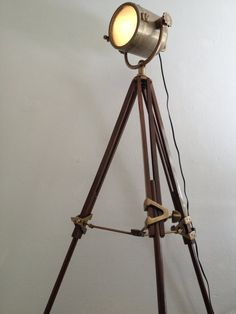 A nautical floor lamp with huge search light attached.