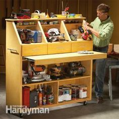 storage card with open bins & shelving pullout work surface. (make this to slide into the center area of the basement storage bin, and take tools, etc., OFF the shelves? Instant work surface)