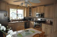 Tuscany style RTA Kitchen Cabinets with large Window that lets in a lot of natural light.