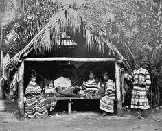 Seminole family and their home known as a chickee, in Florida - 1921.
