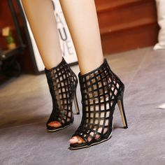 - Sexy open toe cage stiletto high heels for the modern fashionista - Elegant cage design offers a trendy unique look - Great for parties and social events - Zipper at heel for easy access - Made from