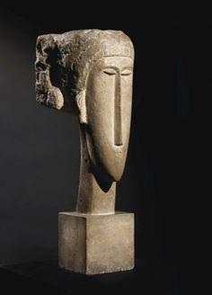 AMEDEO MODIGLIANI (1884-1920) Tête signé 'MODIGLIANI' (à l'arrière) pierre calcaire Hauteur: 64 cm. (25¼ in.) Exécuté vers 1910-12 . (Ceroni XVII)