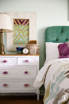 color - that emerald green headboard is lovely