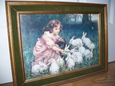 Young Girl feeding White Rabbits by MargsMostlyVintage on Etsy, $36.00