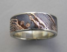 Ring | Susan Amador. 18kt rose gold and shakudo Mokume gane with white gold edges.