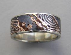 Ring   Susan Amador. 18kt rose gold and shakudo Mokume gane with white gold edges.