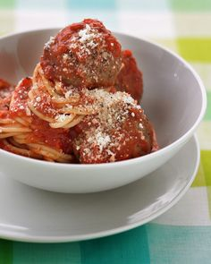 Onion, Italian seasoning, and Parmesan cheese flavor great big meatballs made from lean ground beef. The easy tomato sauce gets a hint of sweetness from grated carrot.