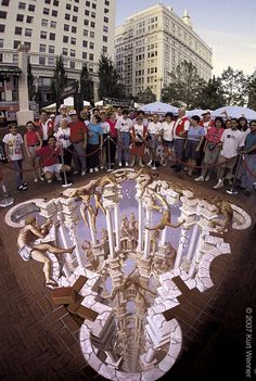 www.kurtwenner.com Kurt Wenner Born in Ann Arbor, in Michigan, this truly pioneering artist is world renowned for realistic chalk murals and street paintings that give rise to fantastic optical illusions of three dimensionality, and are known in the art world as examples of the anamorphic style. So good are the art works that this man produces, that many of them have featured on TV and in many newspapers globally.