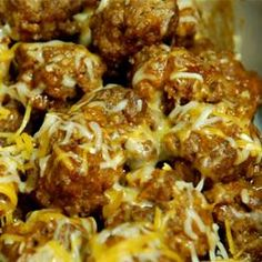 Enchilada meatballs-Looks ridiculously yummy. Serve with Mexican Rice and a bit of shredded lettuce on the side.  Good to go..  :)