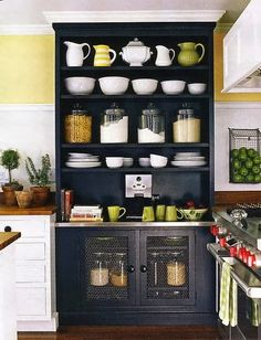 Paint our cabinet black?..nice accent for a white kitchen...with purple and lime green dishes diplayed..