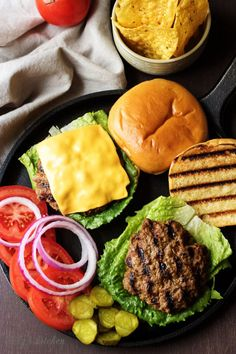 Cheeseburgers with Lettuce, Red Onion, Tomato and Pickles.