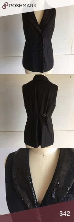 🎶 And all that jazzzzz 🎶 Black tuxedo style vest / sleeveless blazer. Really gives that extra touch to any look. Pairs great over a dress, wide leg pants or leggings, wear over a crop top un button the best and pair with a mini! Takes your basic denim shorts and kicks them up a notch! Sequins in perfect condition, I stored in garment bag and only dry cleaned. Tops