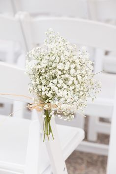 A Baby's Breath bouquet brings a fresh breath of air to the ceremony chairs. photo: www.eyecontact.ca