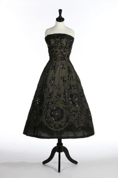 Christian Dior beaded black organza dance dress, circa 1956, labelled and numbered 02161, the strapless bodice with boned integral crepe de chine lining, the gown covered with large sunflower-like beaded motifs, with matching stole
