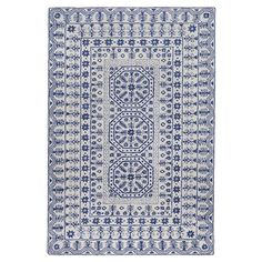 Exquisitely hand-tufted of New Zealand wool, this captivating rug features an intricate floral motif in navy and beige.  Product: