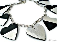 Black Foiled Heart Necklace by Andrijana Katavic - made with Makin's Clay® no bake, air dry polymer clay - http://makinsclayblog.blogspot.com/2016/01/black-silver-heart-necklace-by.html