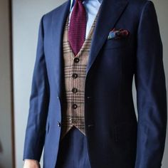 Navy suit over a brown plaid vest / burgundy knit tie and pocket square. What…