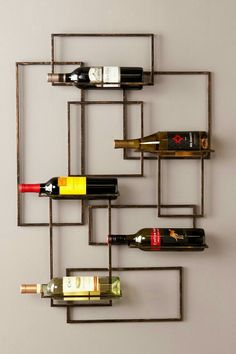 Elegantly accent any unused wall with this abstract, space saving wine storage wall sculpture. A modern, geometric design of interconnecting rectangles displays 5 treasured wine bottles in functional wall art that is truly one-of-a-kind. Cool Wall Decor, Wine Rack Wall, Wine Racks, Wine Display, Nebraska Furniture Mart, Wine Cabinets, Gifts For Wine Lovers, Wine Storage, Wall Mount