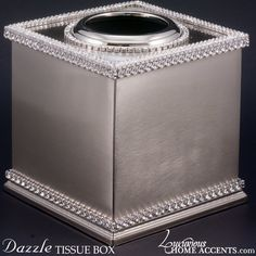 "The Dazzle Swarovski Crystal Tissue Box from Luxurious Home Accents is beautifully appointed with Swarovski Crystal. Authentic Swarovski® Crystals. Rhodium Plated. 5 ¾""T x 4 ¾""W"