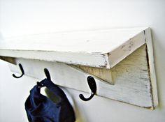 Antique White wood wall shelf with hooks 24 inch rustic Coat Hanger Rack Shabby Chic finish. $29.95, via Etsy.