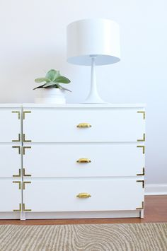 You can give IKEA's ultra-simple Malm drawers the look of an expensive campaign dresser by simply adding brass corner braces and a brass pulls to each drawer. Blogger Jackie DiCi transformed the flat-pack furniture in her Miami home, and it now has much more Floridian flair.