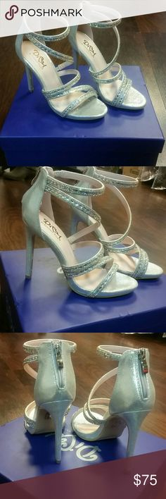 "Strappy Silver Rhinestone Heels Put some sparkle to your outfit! These high quality heels by Benjamin Walk's Diva Collection will have everyone complimenting your shoes. They feature a 4"" heel, ankle strap with multiple others encrusted with AB and clear rhinestones, open toe and slight cushioning for comfort. Great for prom, homecoming, wedding, pageants, parties, or any formal event. New from my boutique, Steve Madden for exposure. Steve Madden Shoes Heels"