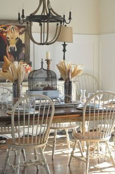 Like these chairs for a farmhouse look....usually see this style chair in the usual brown stain. The distressed vintage white is a nice change.