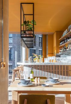 Bright ochre walls and furnishings feature in bar and restaurant Treves & Hyde, designed by Grzywinski+Pons in London's Whitechapel. Imagining an indoor/outdoor kitchen with a sliding partition Cafe Restaurant, Restaurant Design, Restaurant Interiors, Restaurant Furniture, Kitchen Redo, Kitchen Dining, Kitchen Ideas, London Restaurants, Shop Interiors